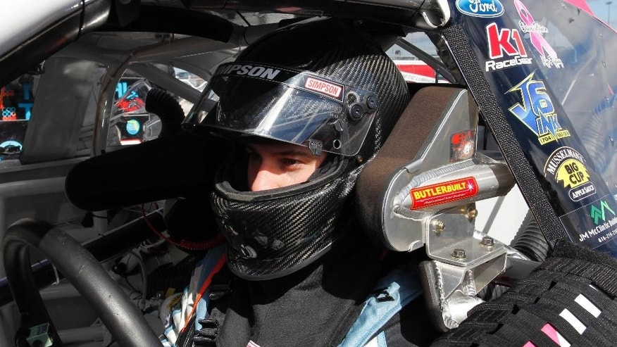 ARCA auto racing driver Mason Mitchell pulls into the garage at Kansas Speedway in Kansas City, Kan., Friday, Oct. 3, 2014. (AP Photo/Colin E. Braley)