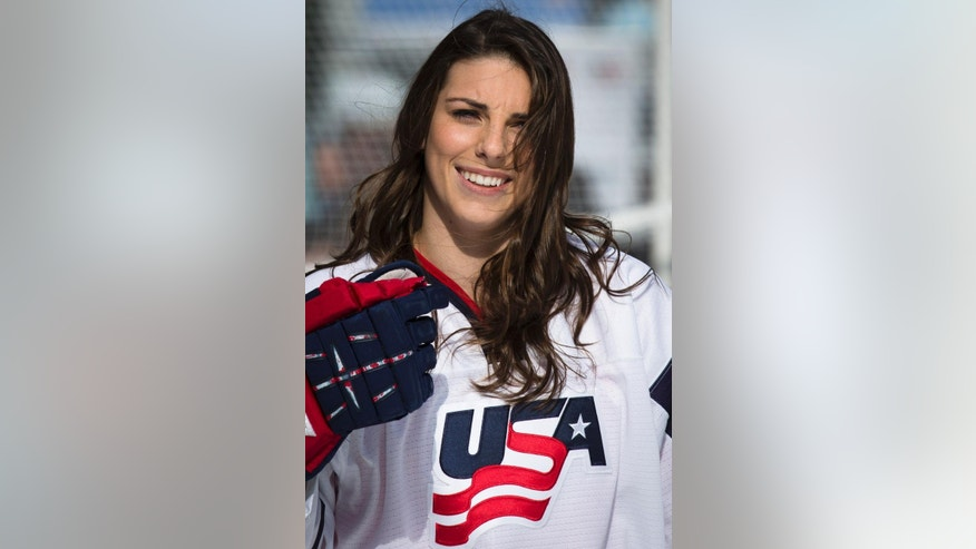 FILE - This Oct. 29, 2013, file photo shows U.S. Olympic hockey player Hilary Knight at a demonstration in New York's Times Square. Knight will practice with the Anaheim Ducks in training camp while spotlighting her drive to bring more young girls into the sport. (AP Photo/John Minchillo, File)