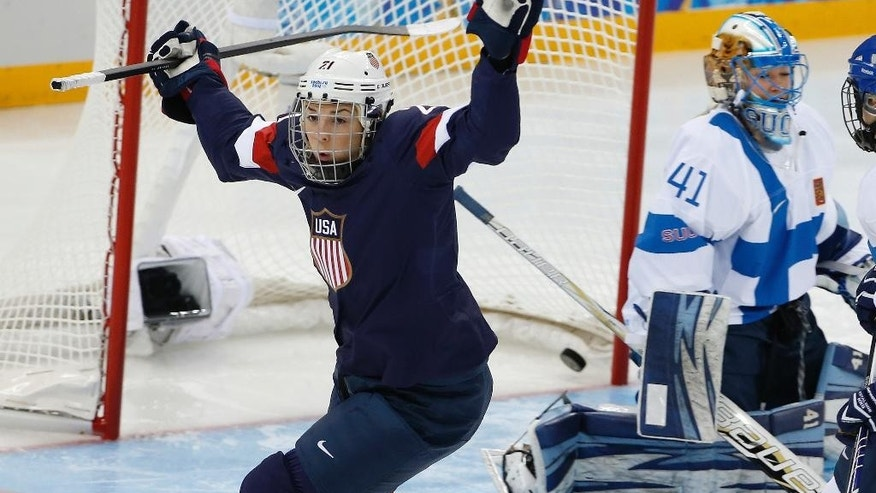 FILE - In this Feb. 8, 2014, file photo, Hilary Knight of the United States celebrates her goal in front of Finland goalkeeper Noora Raty during a women's ice hockey game at the 2014 Winter Olympics in Sochi, Russia. Knight will practice with the Anaheim Ducks in training camp while spotlighting her drive to bring more young girls into the sport. (AP Photo/Petr David Josek, File)