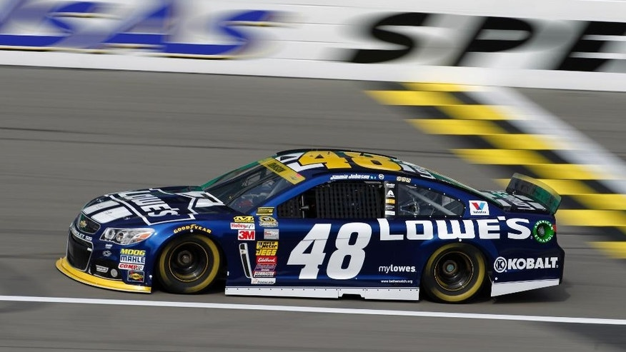 NASCAR Sprint Cup Series driver Jimmie Johnson heads down the track during a practice run at Kansas Speedway in Kansas City, Kan., Saturday, Oct. 4, 2014. (AP Photo/Colin E. Braley)