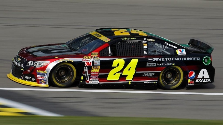 NASCAR Sprint Cup Series driver Jeff Gordon makes his way around the track during a practice run at Kansas Speedway in Kansas City, Kan., Saturday, Oct. 4, 2014. (AP Photo/Colin E. Braley)