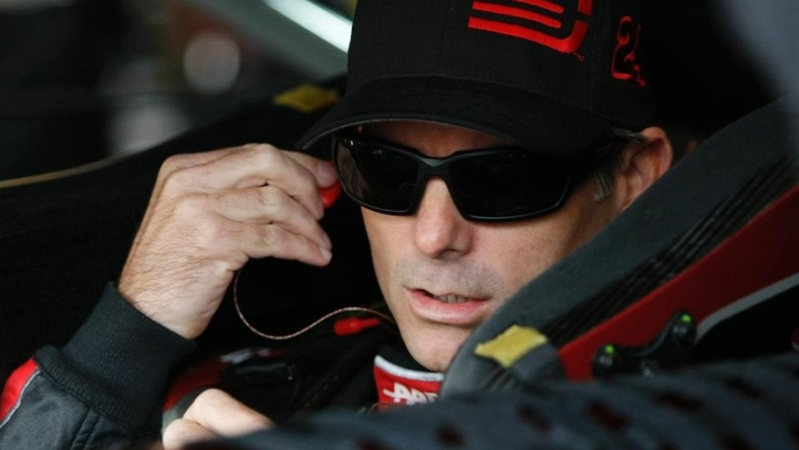 NASCAR auto racing driver Jeff Gordon waits for the start of practice at Kansas Speedway in Kansas City, Kan., Friday, Oct. 3, 2014. (AP Photo/Colin E. Braley)