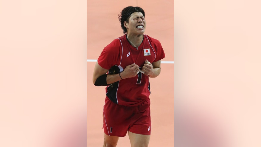 Japan's Kunihiro Shimizu reacts after his  team loosing a point against Iran during the men's volleyball final match at Songnim Gymnasium at the 17th Asian Games in Incheon, South Korea, Friday, Oct. 3, 2014. Iran won the gold medal and Japan with silver medal. (AP Photo/Eugene Hoshiko)