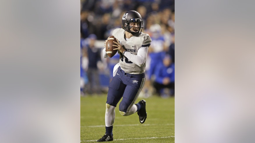 Utah State quarterback Darell Garretson runs on the way to a touchdown in the second quarter during an NCAA college football game against BYU on Friday, Oct. 3, 2014, in Provo, Utah. (AP Photo/Rick Bowmer)