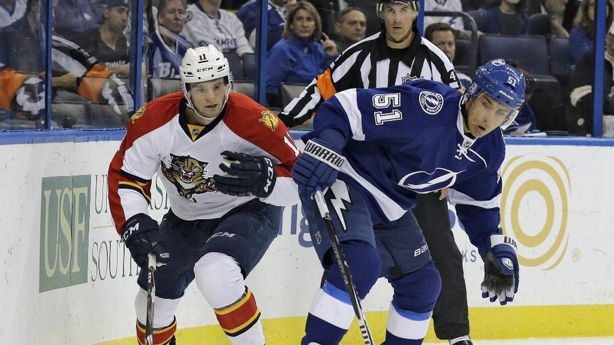 Tampa Bay Lightning center Valtteri Filppula (51) controls the puck against Florida Panthers center Jonathan Huberdeau (11) during the first period of an NHL preseason hockey game Saturday, Oct. 4, 2014, in Tampa, Fla. (AP Photo/Chris O'Meara)