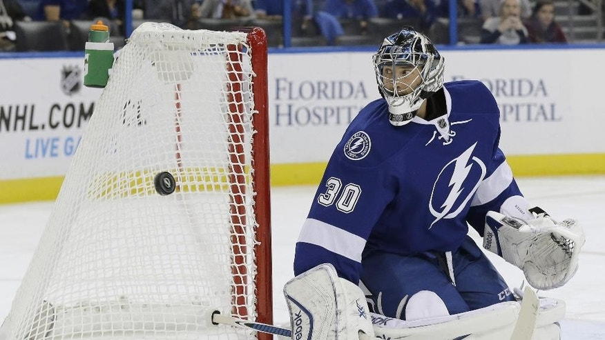 Tampa Bay Lightning goalie Ben Bishop (30) makes a stick save on a shot by the Florida Panthers during the first period of an NHL preseason hockey game Saturday, Oct. 4, 2014, in Tampa, Fla. (AP Photo/Chris O'Meara)