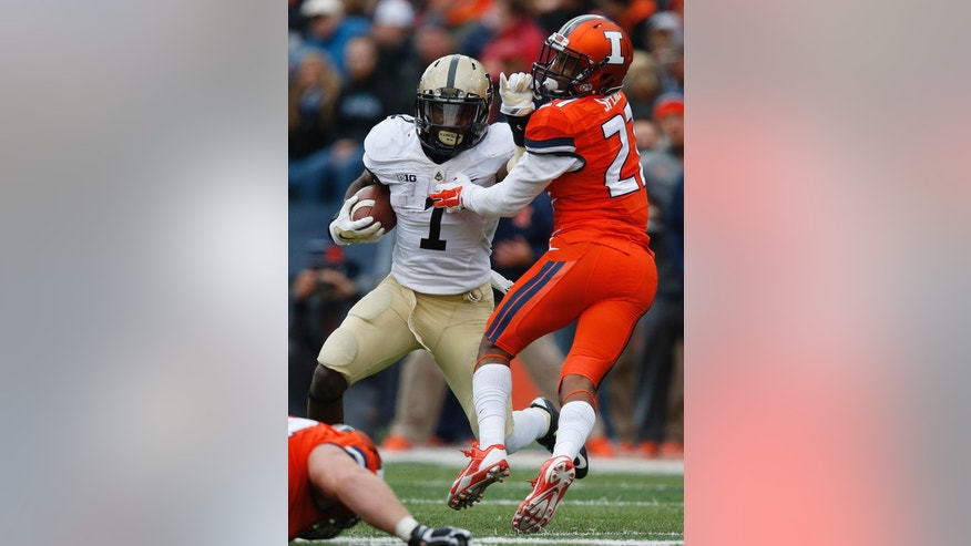 Purdue running back Akeem Hunt (1) evades Illinois defensive back Eaton Spence (27) during the first half of an NCAA college football game on Saturday, Oct. 4, 2014, in Champaign, Ill. (AP Photo/Andrew A. Nelles)