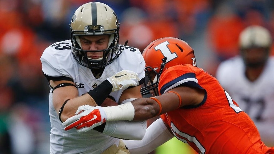Purdue wide receiver Danny Anthrop (33) takes a hit from Illinois defensive back Zane Petty (21) during the first half of an NCAA college football game on Saturday, Oct. 4, 2014, in Champaign, Ill. (AP Photo/Andrew A. Nelles)