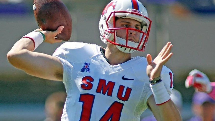 Southern Methodist's Garrett Krstich (14) prepares to throw the ball during the first half of an NCAA college football game against East Carolina in Greenville, N.C., Saturday, Oct. 4, 2014. (AP Photo/Karl B DeBlaker)