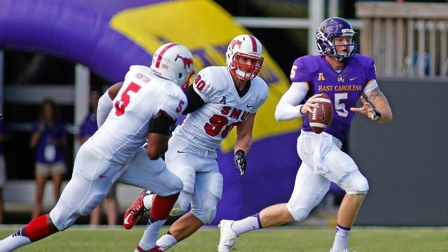 East Carolina's Shane Carden (5) scrambles away from Southern Methodist's Nick Horton (5) and Zach Wood (90) during the first half of an NCAA college football game in Greenville, N.C., Saturday, Oct. 4, 2014. (AP Photo/Karl B DeBlaker)