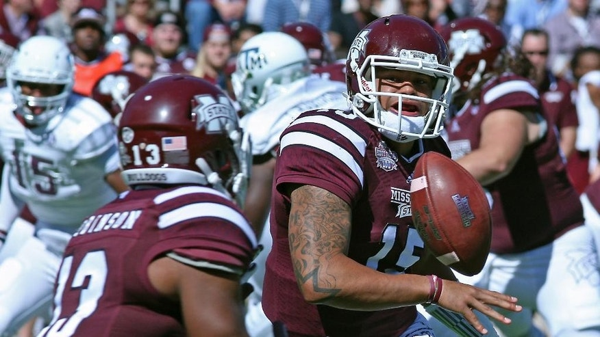 Mississippi State quarterback Dak Prescott (15) pitches the ball to running back Josh Robinson (13) during the first half of an NCAA college football gameagainst Texas A&M in Starkville, Miss., Saturday, Oct. 4, 2014. (AP Photo/Jim Lytle)