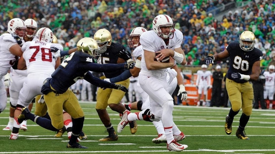 Stanford quarterback Kevin Hogan (8) runs 10-yards for a touchdown during the first half of an NCAA college football game against Notre Dame, Saturday, Oct. 4, 2014, in South Bend, Ind. (AP Photo/Darron Cummings)