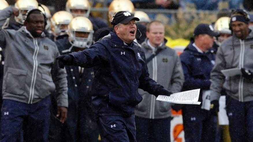 Notre Dame head coach Brian Kelly calls a play during the first half of an NCAA college football game against Stanford, Saturday, Oct. 4, 2014, in South Bend, Ind. (AP Photo/Darron Cummings)