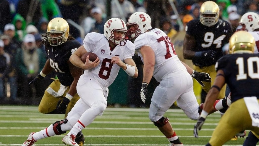Stanford quarterback Kevin Hogan (8) runs during the first half of an NCAA college football game against Stanford, Saturday, Oct. 4, 2014, in South Bend, Ind. (AP Photo/Darron Cummings)