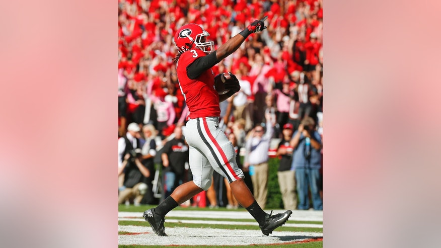 Georgia running back Todd Gurley (3) reacts after rushing for  a touchdown in the first half of an NCAA college football game against Vanderbilt  Saturday, Oct. 4, 2014, in Athens, Ga.  (AP Photo/John Bazemore)