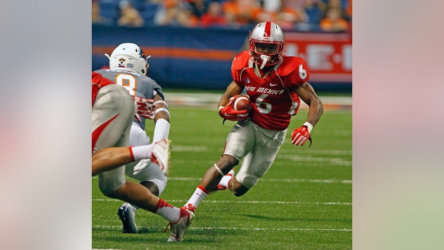 New Mexico running back Jhurell Pressley (6) runs with the ball during the first quarter of an NCAA college football game against  UTSA in San Antonio, Texas, Saturday, Oct. 4, 2014. (AP Photo/Michael Thomas)