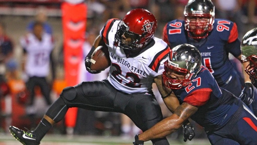 Fresno State's Donavon Lewis stops San Diego State's Chase Price during the first half of an NCAA college football game in Fresno, Calif., Friday, Oct. 3, 2014. (AP Photo/Gary Kazanjian)