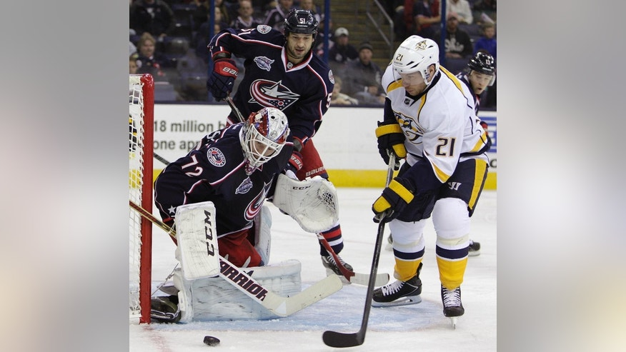 Columbus Blue Jackets' Sergei Bobrovsky, left, of Russia, makes a save as teammate Fedor Tyutin, center, of Russia, and Nashville Predators' Derek Roy look for the rebound during the third period of a preseason NHL hockey game Saturday, Oct. 4, 2014, in Columbus, Ohio. The Blue Jackets beat the Predators 3-2. (AP Photo/Jay LaPrete)