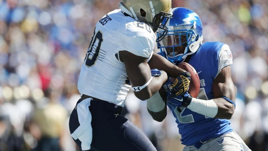 Air Force defensive back Christian Spears, right, intercepts pass in end zone intended for Navy slotback Calvin Cass Jr. in the second quarter of an NCAA college football game at Air Force Academy, Colo., on Saturday, Oct. 4, 2014. (AP Photo/David Zalubowski)