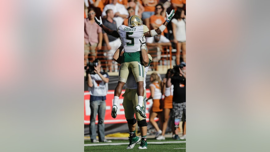 Baylor's Antwan Goodley (5) is lifted after he scored against Texas during the second half of an NCAA college football game, Saturday, Oct. 4, 2014, in Austin, Texas. (AP Photo/Eric Gay)