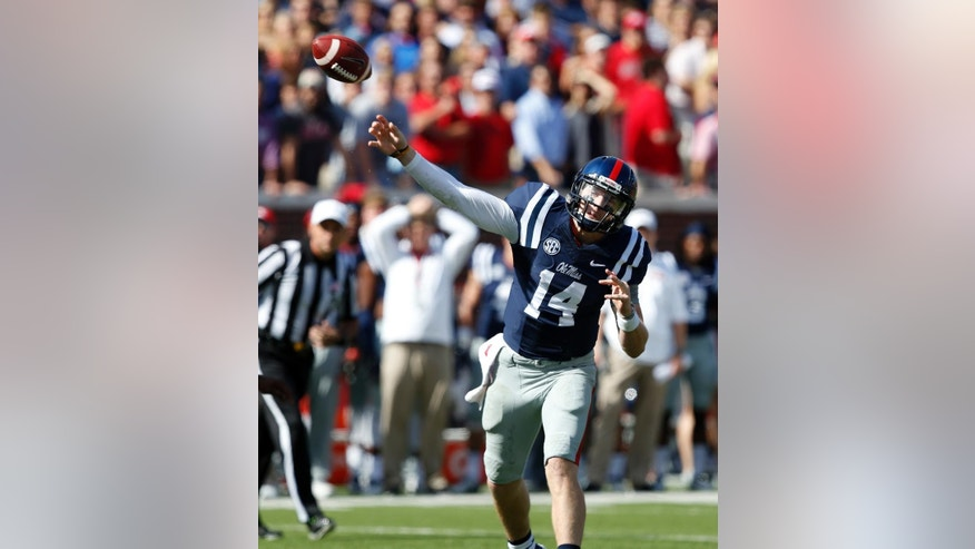 Mississippi quarterback Bo Wallace (14) passes against Alabama during first half of an NCAA college football game in Oxford, Miss., Saturday, Oct. 4, 2014. (AP Photo/Rogelio V. Solis)