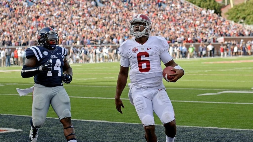 Alabama quarterback Blake Sims (6) scores a touchdown past Mississippi linebacker Serderius Bryant (14) during the first half of an NCAA college football game in Oxford, Miss., Saturday, Oct. 4, 2014. (AP Photo/The Daily Mississippian, Thomas Graning)