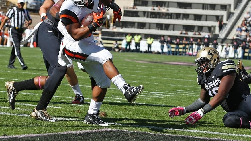 Oregon State running back Terron Ward (28) scores a touchdown against Colorado in the first half of an NCAA college football game in Boulder, Colo., on Saturday, Oct. 4, 2014. (AP Photo/Brennan Linsley)