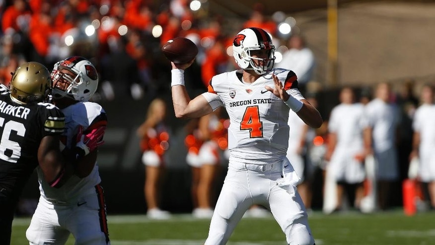 Oregon State quarterback Sean Mannion (4) throws during the first half of an NCAA college football game against Colorado in Boulder, Colo., Saturday, Oct. 4, 2014. (AP Photo/Brennan Linsley)