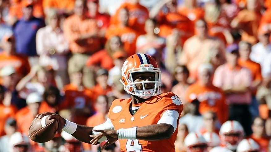Clemson quarterback Deshaun Watson (4) looks to pass against North Carolina State during the first half of an NCAA college football game, Saturday, Oct. 4, 2014, in Clemson, S.C. (AP Photo/Rainier Ehrhardt)