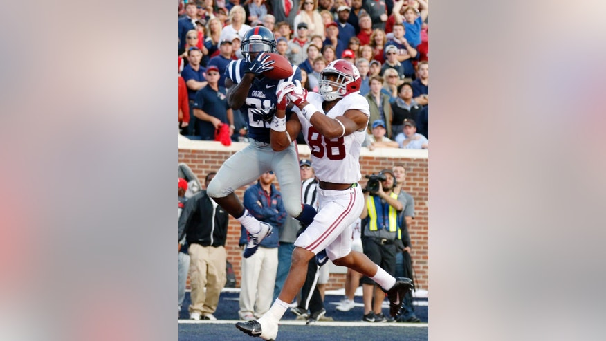 Mississippi defensive back Senquez Golson (21) intercepts a pass in the end zone intended for Alabama tight end O.J. Howard (88) during the fourth quarter of an NCAA college football game in Oxford, Miss., Saturday, Oct. 4, 2014. No. 11 Mississippi beat No. 3 Alabama 23-17. (AP Photo/Rogelio V. Solis)