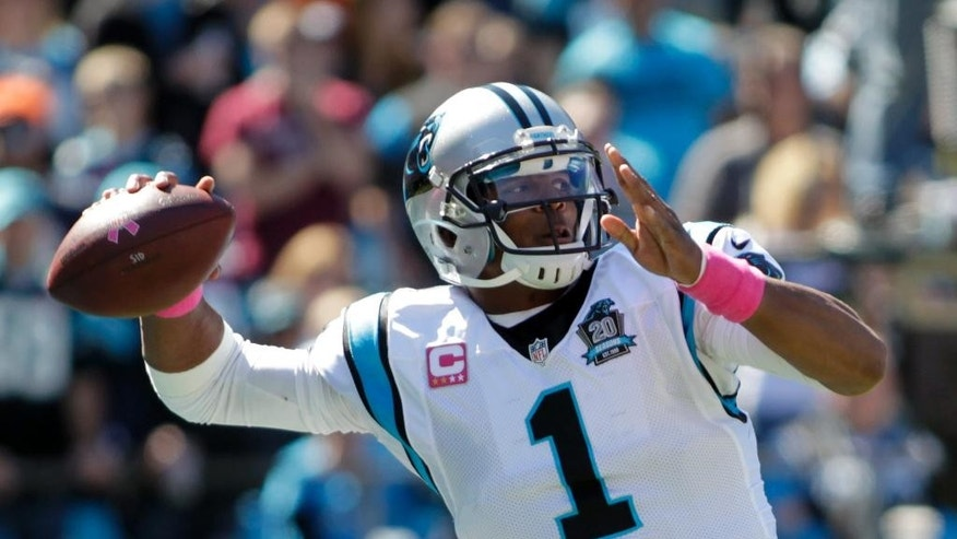 Carolina Panthers quarterback Cam Newton (1) looks to pass against the Chicago Bears during the first half of an NFL football game in Charlotte, N.C., Sunday, Oct. 5, 2014. (AP Photo/Bob Leverone)
