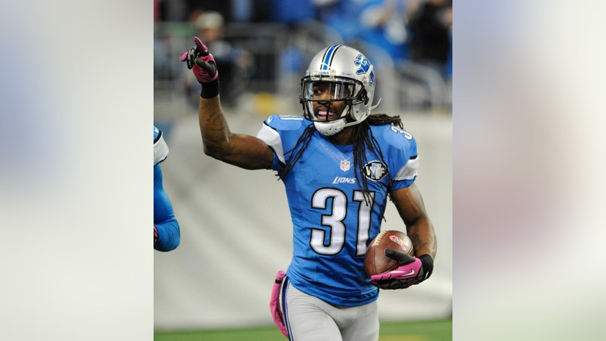 Detroit Lions cornerback Rashean Mathis celebrates after scoring a 41-yard touchdown in the second quarter of an NFL football game against the Buffalo Bills, Sunday, Oct. 5, 2014, in Detroit. (AP Photo/Jose Juarez)