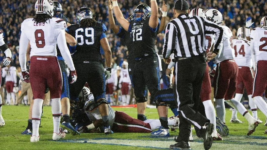 Kentucky center Jon Toth, signals a touchdown after Kentucky's Jojo Kemp scored to tie the game during the second half of an NCAA college football game in Lexington, Ky., Saturday, Oct. 4, 2014. Kentucky won 45-38. (AP Photo/David Stephenson)