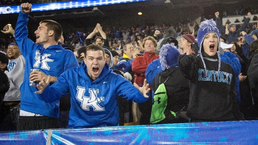 Kentucky fans celebrate in the final moments of Kentucky's 45-38  win over South Carolina in an NCAA college football game in Lexington, Ky., Saturday, Oct. 4, 2014. (AP Photo/David Stephenson)