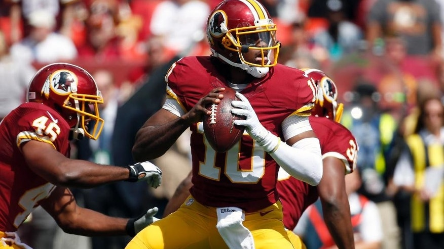ADVANCE FOR WEEKEND EDITIONS OCT 4-5 - FILE - In this Sunday, Sept. 14, 2014 file photo, Washington Redskins quarterback Robert Griffin III (10) looks to pass during the first half of an NFL football game against the Jacksonville Jaguars in Landover, Md. The NFL's injury epidemic began even before any preseason games were played. Since then, big-name players (RG3, Knowshon Moreno, Sam Bradford, B.J. Raji, DeAngelo Hall, Chris Long) have been sidelined, Thursday, Oct. 2, 2014. (AP Photo/Alex Brandon, File)