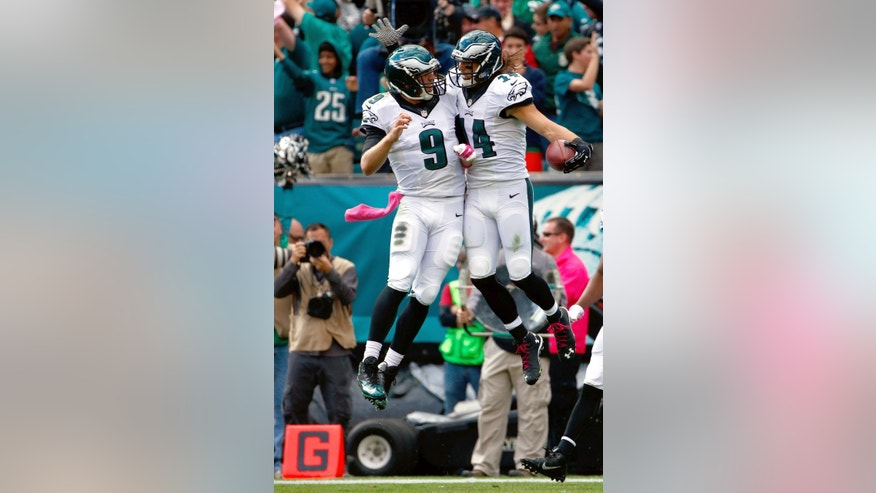 Philadelphia Eagles' Riley Cooper, right, and Nick Foles celebrate after Cooper's touchdown during the first half of an NFL football game against the St. Louis Rams, Sunday, Oct. 5, 2014, in Philadelphia. (AP Photo/Matt Rourke)
