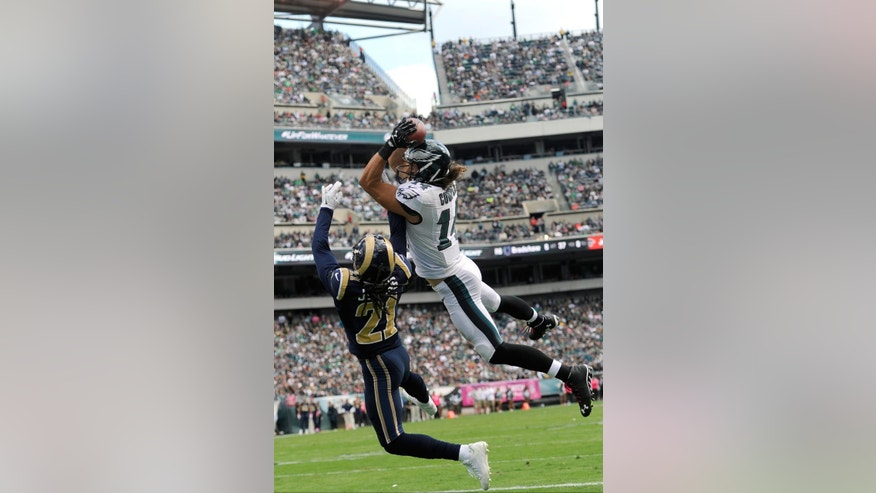 Philadelphia Eagles' Riley Cooper (14) pulls in a touchdown pass against St. Louis Rams' Janoris Jenkins (21) during the first half of an NFL football game, Sunday, Oct. 5, 2014, in Philadelphia. (AP Photo/Michael Perez)