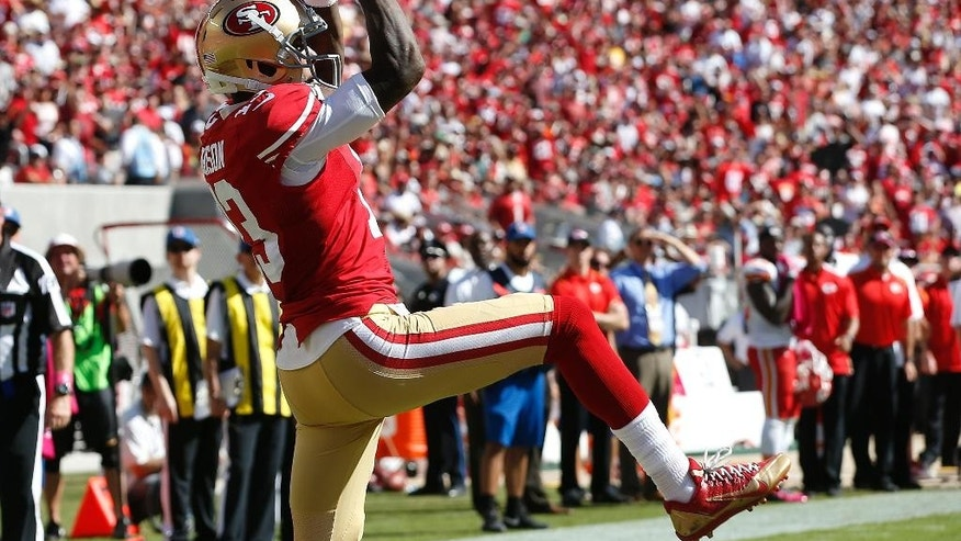 San Francisco 49ers wide receiver Steve Johnson (13) catches a 9-yard touchdown pass from Colin Kaepernick against the Kansas City Chiefs during the second quarter of an NFL football game in Santa Clara, Calif., Sunday, Oct. 5, 2014. (AP Photo/Tony Avelar)