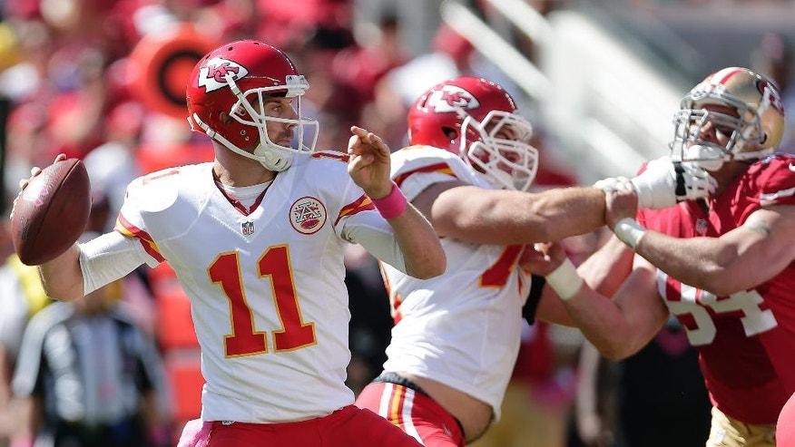 Kansas City Chiefs quarterback Alex Smith (11) passes against the San Francisco 49ers during the first quarter of an NFL football game in Santa Clara, Calif., Sunday, Oct. 5, 2014. (AP Photo/Marcio Jose Sanchez)