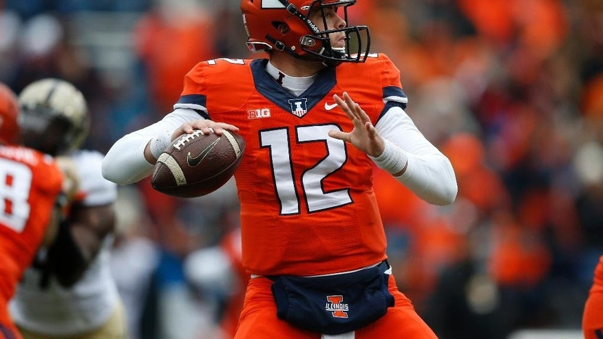 Illinois quarterback Wes Lunt (12) throws against Purdue during the second half of an NCAA college football game on Saturday, Oct. 4, 2014, in Champaign, Ill. (AP Photo/Andrew A. Nelles)