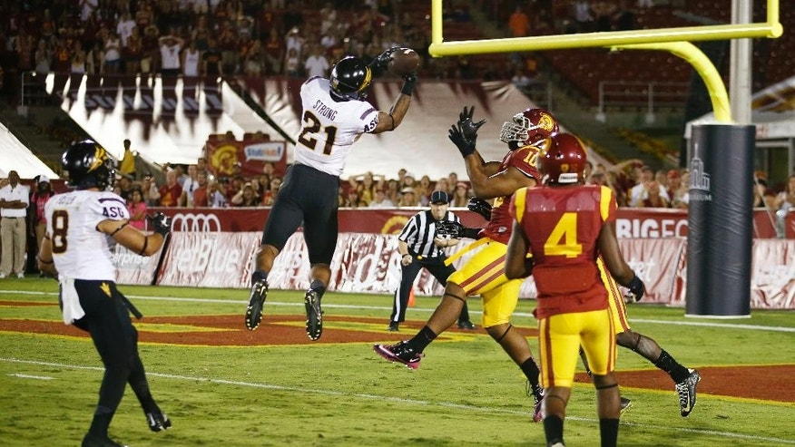 "Arizona State's Jaelen Strong catches a 49-yard ""hail mary"" pass from Mike Bercovici to defeat USC on the final play of the game on Saturday, Oct. 4, 2014 at Memorial Coliseum in Los Angeles, CA. (AP Photo/The Arizona Republic, Rob Schumacher)"