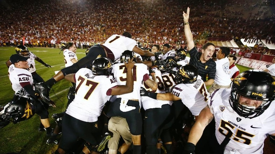 "Arizona State celebrates Jaelen Strong's catching a 49-yard ""hail mary"" pass from Mike Bercovici to defeat USC on the final play of the game on Saturday, Oct. 4, 2014 at Memorial Coliseum in Los Angeles, CA. (AP Photo/The Arizona Republic, Rob Schumacher)"