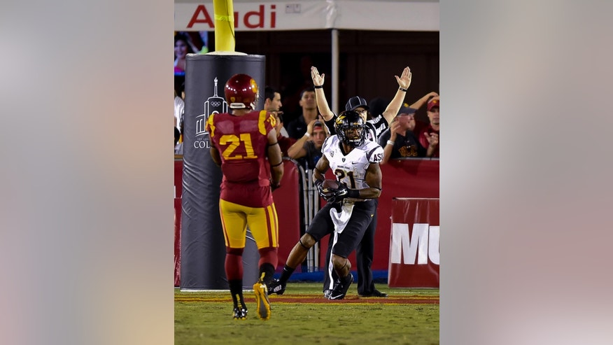 Southern California safety Su'a Cravens, left, looks on as Arizona State wide receiver Jaelen Strong, front right, scores a game-winning touchdown during the second half of an NCAA college football game, Saturday, Oct. 4, 2014, in Los Angeles. Arizona State won 38-34. (AP Photo/Gus Ruelas)