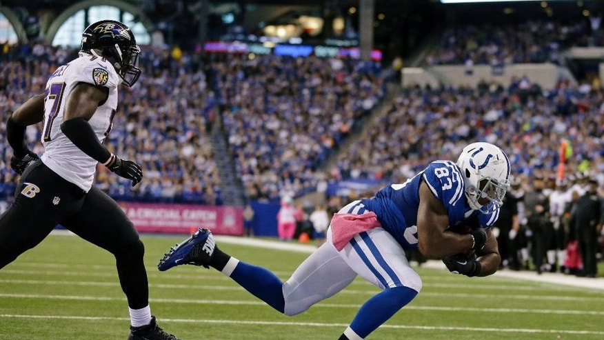 Indianapolis Colts tight end Dwayne Allen, right, makes a catch for a touchdown in front of Baltimore Ravens inside linebacker C.J. Mosley during the second half of an NFL football game in Indianapolis, Sunday, Oct. 5, 2014. (AP Photo/Jeff Roberson)