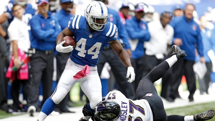 Indianapolis Colts running back Ahmad Bradshaw (44) is tackled by Baltimore Ravens inside linebacker C.J. Mosley during the first half of an NFL football game in Indianapolis, Sunday, Oct. 5, 2014. (AP Photo/AJ Mast)