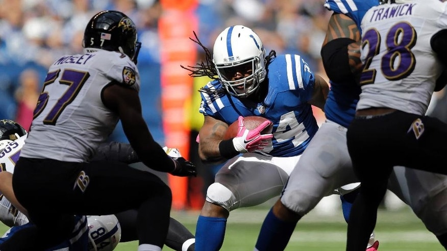 Indianapolis Colts running back Trent Richardson cuts in front of Baltimore Ravens inside linebacker C.J. Mosley during the first half of an NFL football game in Indianapolis, Sunday, Oct. 5, 2014. (AP Photo/Jeff Roberson)