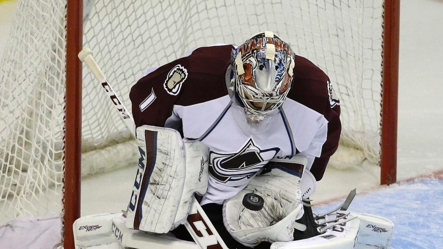 Colorado Avalanche goalie Semyon Varlamov (1) makes a save during the third period of their NHL preseason hockey game against the Los Angeles Kings Saturday, Oct. 4, 2014, in Las Vegas. (AP Photo/John Locher)