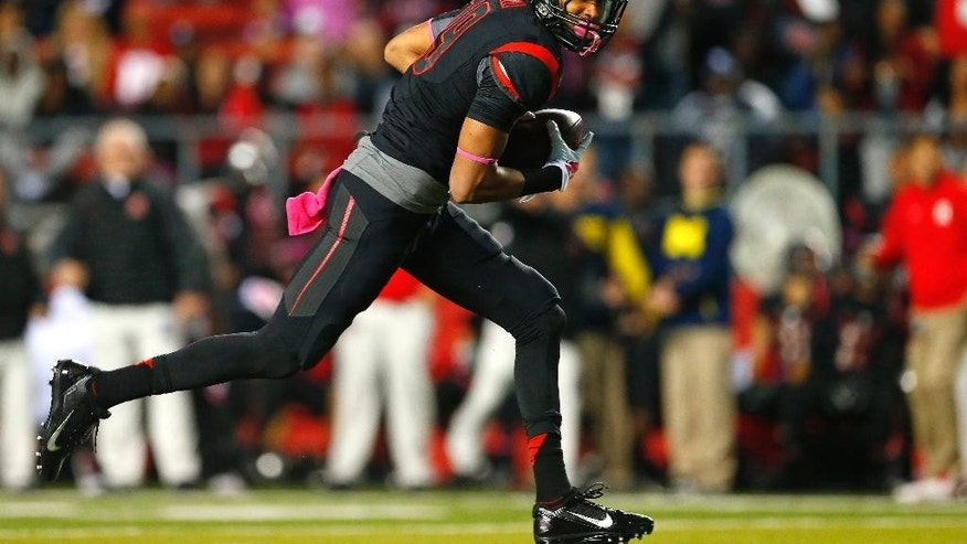 Rutgers wide receiver Andrew Turzilli runs on the way to a touchdown reception against Michigan during the first half of an NCAA college football game Saturday, Oct. 4, 2014, in Piscataway, N.J. (AP Photo/Rich Schultz)