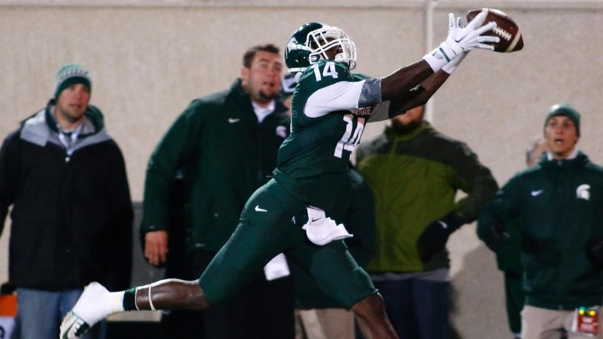 Michigan State receiver Tony Lippett (14) catches a 55-yard pass for a touchdown against Nebraska during the first quarter of an NCAA college football game, Saturday, Oct. 4, 2014, in East Lansing, Mich. (AP Photo/Al Goldis)