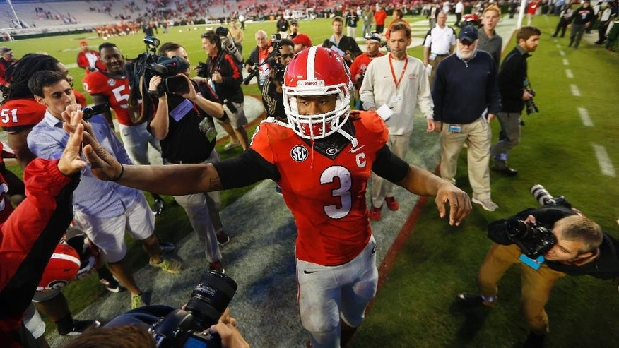 Georgia running back Todd Gurley (3) celebrates with fans after defeating Vanderbilt  44-17 in an NCAA college football game Saturday, Oct. 4, 2014, in Athens, Ga. (AP Photo/John Bazemore)